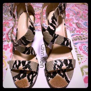 Size 8 snake skin heels by Calvin Klein